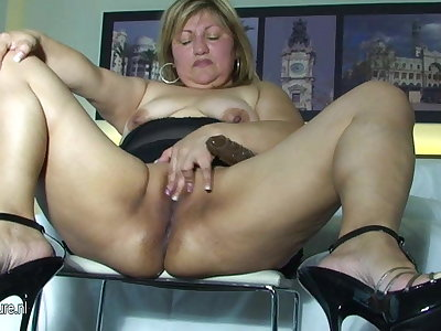Big mama playing with her shaved pussy