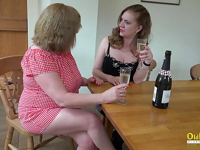 Two horny mature lesbians slowly stripping and playing upon their huge boobs