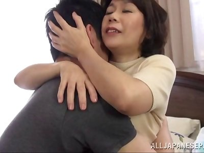 He takes a Japanese milf to bed and satisfies say no to cunt