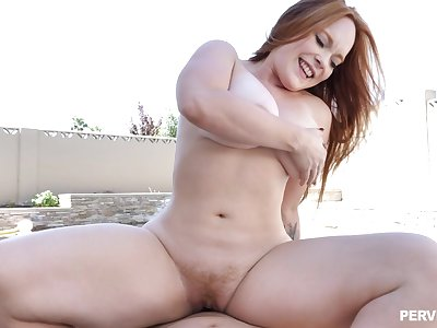 Outdoor passion for a catch married redhead with big tits