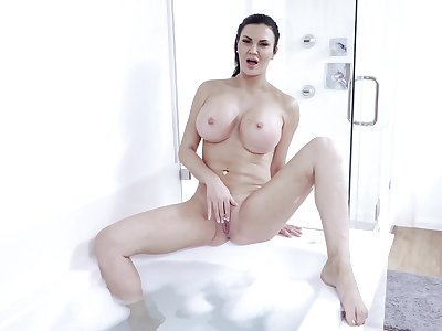 Brunette mature reveals pussy coupled with tits in transparent solo cam play
