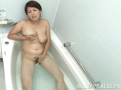 Mature Asian wife Nozomi Sasayama loves teasing with her puss